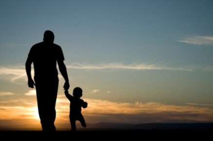 father-and-son-walking-sunset